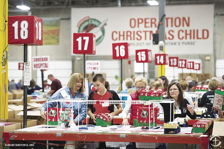 Volunteers ready donated shoeboxes for shipment to children across the globe as part of Samaritan's Purse's annual Operation Christmas Child gift drive.