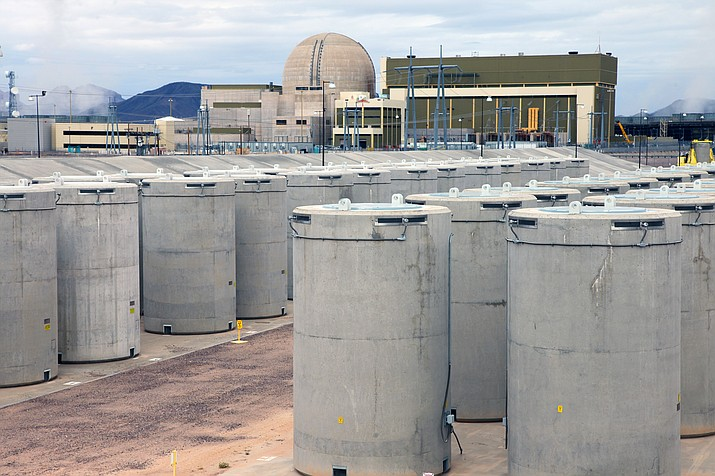 This file photo from 2015 pictures a football-field-sized storage facility on the grounds of Palo Verde Nuclear Generating Station, where 144 20-foot tall concrete casks contain the station's spent fuel rods. The casks require no power, but are monitored continuously. (APS/Courtesy)