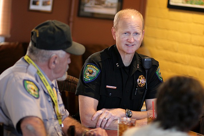 Camp Verde Commander Brian Armstrong, right, leads Monday's Coffee with a Cop at Thanks a Latte. (Photo by Bill Helm)