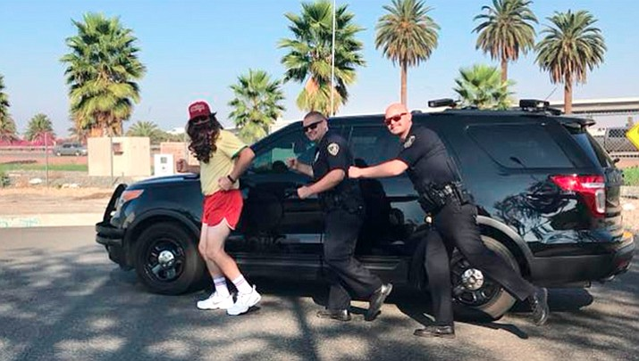 Riverside Police Department captured video and photos of a man dressed as Forrest Gump who has been running around California neighborhoods and stopping to take pictures with residents. (Riverside Police Department)
