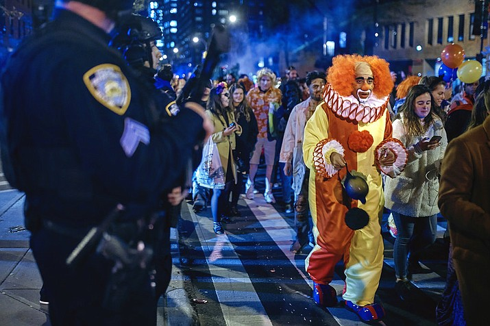 Heavily armed police guard as revelers march during the Greenwich Village Halloween Parade, Tuesday, Oct. 31, 2017, in New York. (AP Photo/Andres Kudacki)