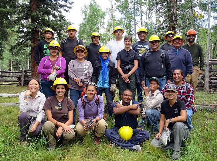 Staff from both the Kaibab National Forest and Grand Canyon Trust work together with the Hopi Youth to rebuild fencing at Fracas Lake and Dog Lake, located on the North Kaibab Ranger District, as part of the Waters for Life Youth Service Project.