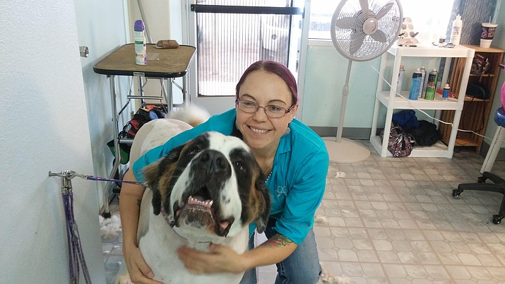 One Love Pet Spa opened Oct. 4. It is located 101 S. Main St., Suite E, in Cottonwood. Co-owner Jana McClain is pictured here with a happy client. (Photo Courtesy of Jana McClain)