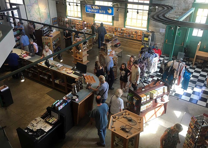 Visitors stop in at the Powerhouse Visitor Center and Museum in Kingman, which has undergone a $250,000 remodeling that was completed Oct. 25. The project includes a new entrance and expanded gift shop.