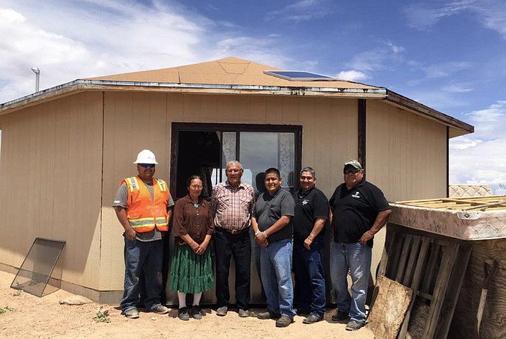 Council Delegate Otto Tso, Big Navajo Energy president Dory Peters and the Lloyd Billy family at their residence near the community of Tuba City, Arizona. Billy's residence now has power and heating in his home. Submitted photo