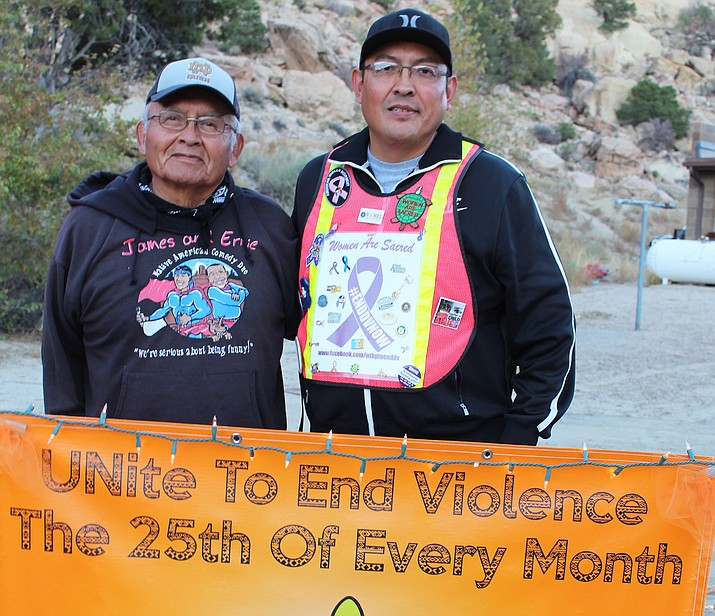 Ernie Tsosie with son John Tsosie. Both continue the fight against domestic violence. Stan Bindell/NHO
