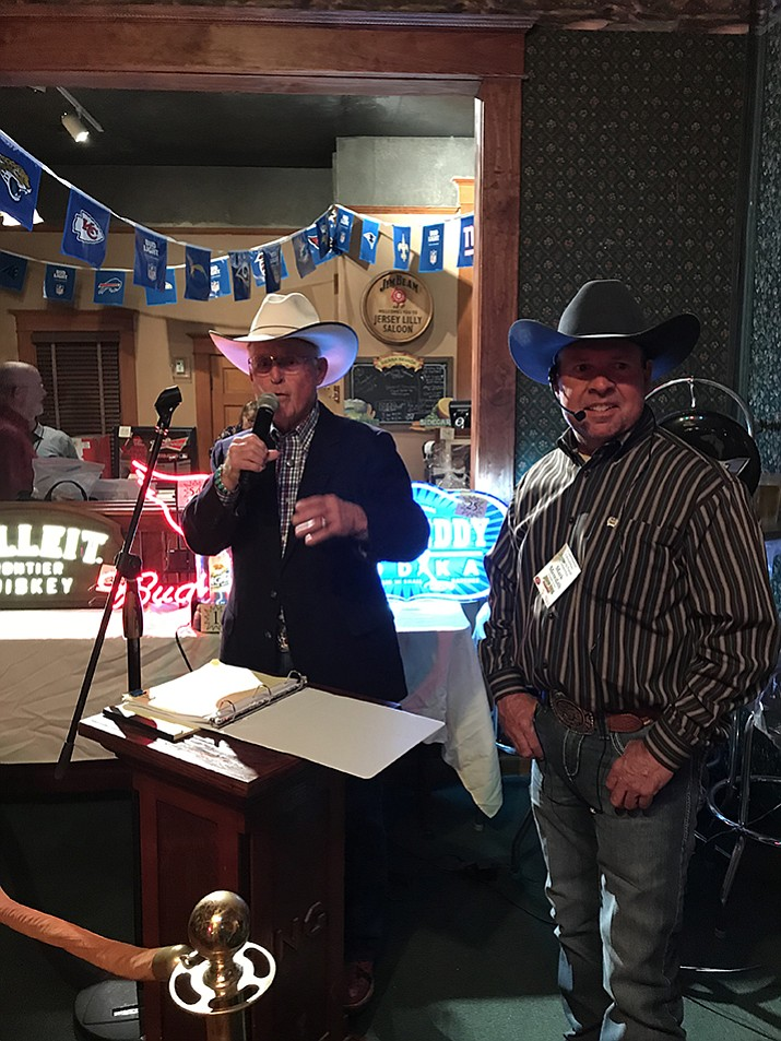 Tommy and Mark Meredith conduct the live auction Thursday, Nov. 2, at the Jersey Lilly Saloon, as part of the Friends of Jersey Lilly fundraiser. The event helps pay for the annual Courthouse Lighting downtown.