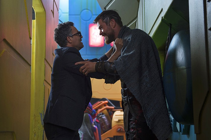 "This image released by Marvel Studios shows Mark Ruffalo and Chris Hemsworth in a scene from, ""Thor: Ragnarok."" (Jasin Boland/Marvel Studios via AP)"