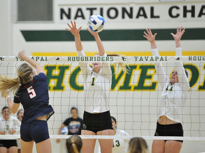 Yavapai's Madelynne McKeown makes a block as the Roughriders take on Seminole State in the NJCAA Region 1/District B semifinal game Wednesday night in Prescott.