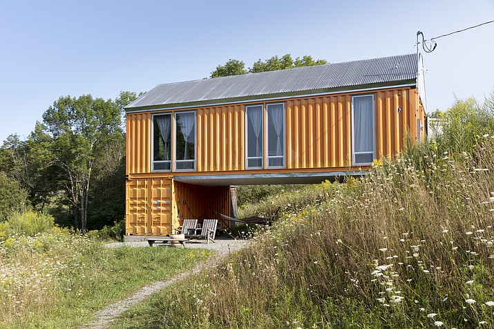 This undated photo provided by Tim Steele shows a container home designed and built by Steele House along with Bigprototype in Livingston Manor, N.Y. (Nils Schlebusch/Tim Steele via AP)