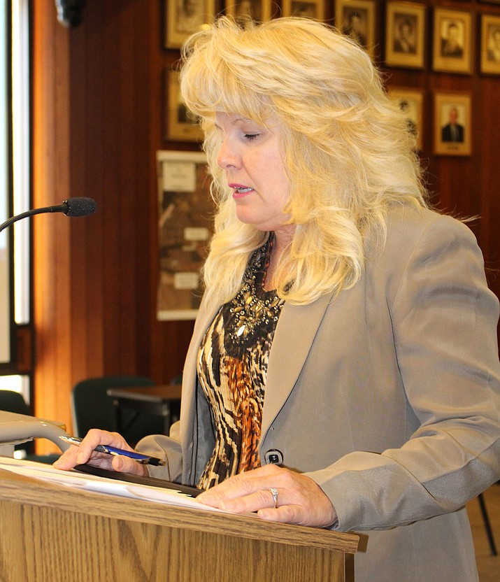 Jackie Walker, human resources director, speaks at a special council meeting Thursday. She said the hiring firm Springsted-Waters is charging the city $24,500, plus $1,650, for the process of hiring a new City Manager.