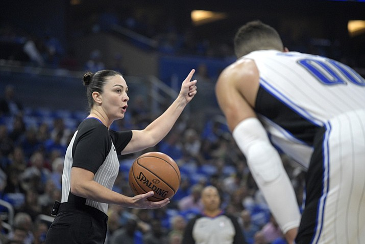 In this Oct. 18, 2017, file photo, official Lauren Holtkamp gestures in front of Orlando Magic forward Aaron Gordon during the first half of an NBA basketball game against the Miami Heat, in Orlando, Fla. (Phelan M. Ebenhack/AP, File)