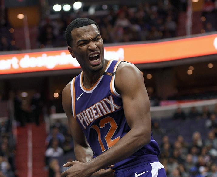 Phoenix Suns forward TJ Warren (12) reacts during the second half of an NBA basketball game against the Washington Wizards, Wednesday, Nov. 1, in Washington. The Suns won 122-116. (Nick Wass/AP)