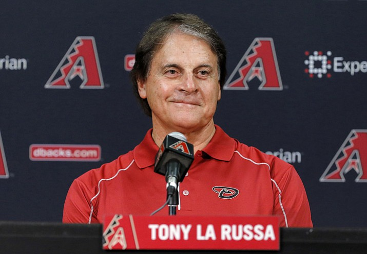 In this May 17, 2014, file photo, Tony La Russa speaks to reporters after being introduced in Phoenix. The Boston Red Sox have hired La Russa  to serve as a vice president and special assistant on its baseball operations staff, the announced Thursday, Nov. 2, 2017.  He served the past four seasons as the Arizona Diamondbacks chief baseball analyst, advising Arizona's baseball operations department. (Matt York/AP, File)