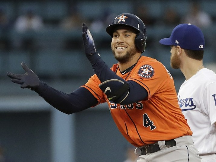 Houston Astros' George Springer reacts after hitting a double during the first inning of Game 7 of baseball's World Series against the Los Angeles Dodgers Wednesday, Nov. 1, 2017, in Los Angeles. (AP Photo/David J. Phillip)