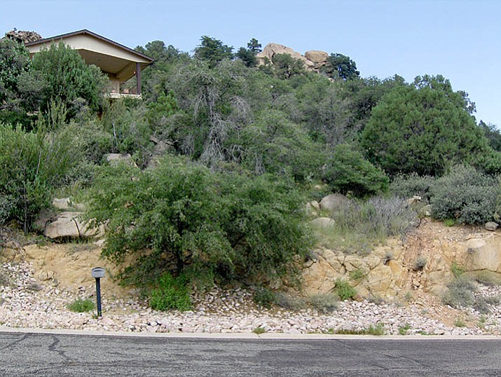 This residence in the Prescott Skyline Firewise Community needed its trees and bushes thinned to limit the risk of wildfire and to create defensible space for firefighters' safety.
