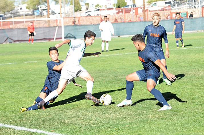 Yavapai sophomore attacker Carlo Quesada attempts to dribble through the Pima defense during the 2017 NJCAA Division I West District championship match Saturday, Nov. 4, 2017, at Ken Lindley Field in Prescott. The Roughriders beat Pima, 2-0, and will play in nationals Nov. 13-15, 17 and 18 in Prescott Valley.