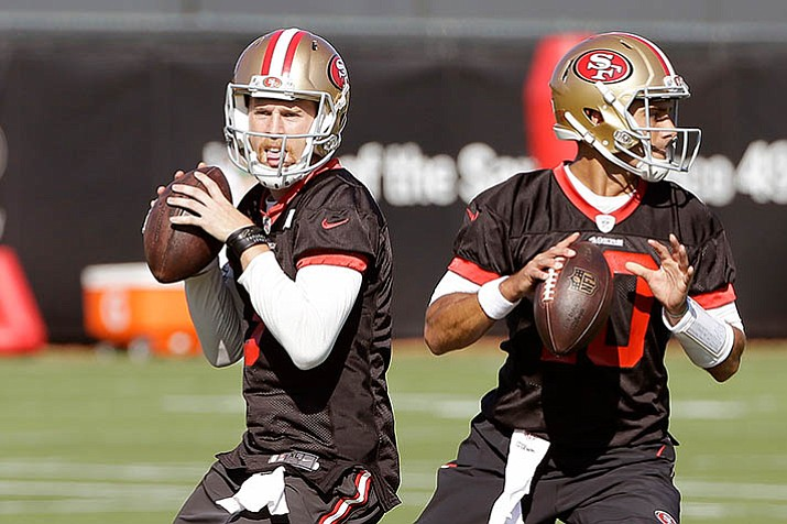 San Francisco 49ers quarterbacks C.J. Beathard, left, and Jimmy Garoppolo throw during a practice at the team's NFL training facility in Santa Clara, Calif., Wednesday, Nov. 1, 2017. (Jeff Chiu/AP)