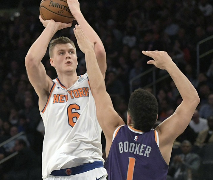 New York Knicks forward Kristaps Porzingis (6) shoots over Phoenix Suns guard Devin Booker (1) during the second quarter Friday, Nov. 3, 2017, at Madison Square Garden in New York. (Bill Kostroun/AP)