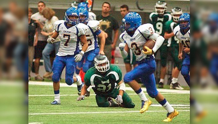 Gabe Lumas returns one of his seven interceptions during a 2011 game against Flagstaff High.