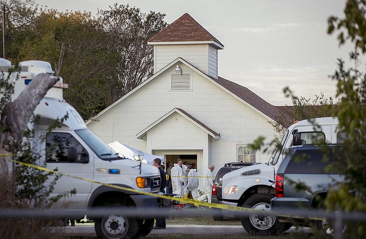 Investigators work at the scene of a deadly shooting at the First Baptist Church in Sutherland Springs, Texas, Sunday Nov. 5, 2017. A man opened fire inside of the church in the small South Texas community on Sunday, killing more than 20 people. (Jay Janner/Austin American-Statesman via AP)
