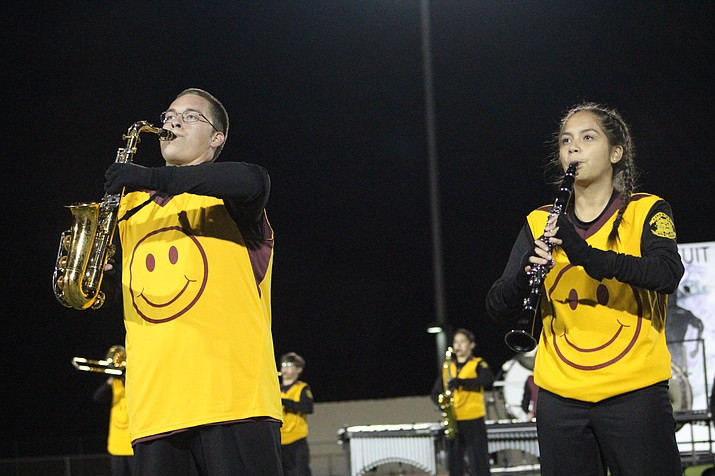 "Evan Forbes, left, and Alexis Davis, right, during their performance ""Pursuit of Happiness"" at the Kingman High School Marching Band exhibition Nov. 2."