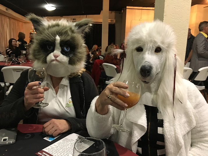 Mohave County Supervisor Jean Bishop and her friend from Meadview wore the best masks at Saturday's Wine and Whiskers Muttsquerade fundraiser.