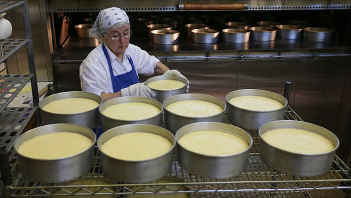 Sister Patricia removes cheesecakes from an oven at New Skete (SKEET) monastery kitchens in Cambridge, N.Y. New York State Police say they've charged a 48-year-old woman with stealing $250 worth of the nuns' baked goods. (AP 2015 File photo/Mike Groll)