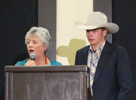 "Lori Gaucher, board member, left, presents a ""Heritage Keeper"" Scholarship to JC Mortensen for his rodeo accomplishments. (Prescott Western Heritage Foundation/Courtesy)"