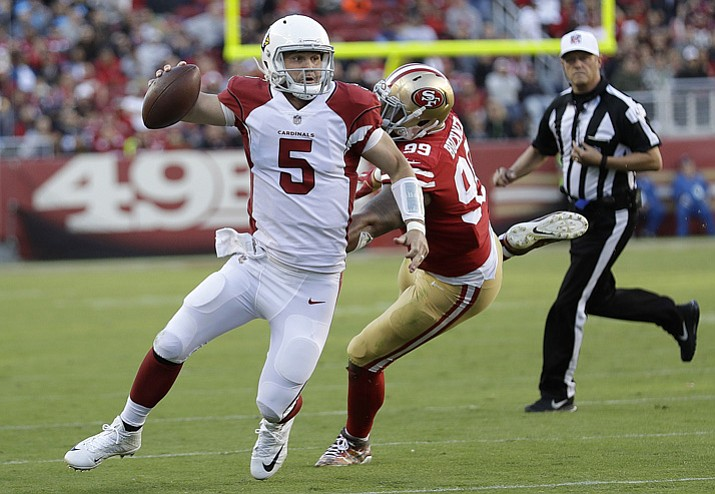 Arizona Cardinals quarterback Drew Stanton (5) scrambles from San Francisco 49ers defensive end DeForest Buckner (99) during the second half Sunday, Nov. 5, 2017, Santa Clara, Calif. (Marcio Jose Sanchez/AP)