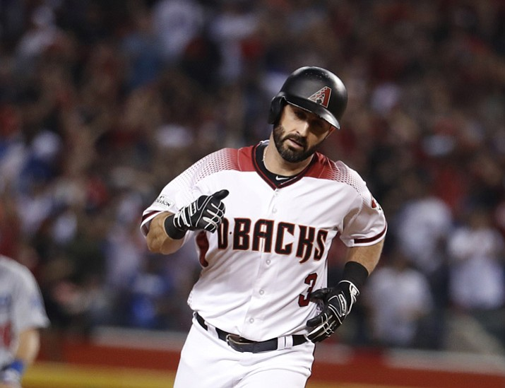 Arizona Diamondbacks second baseman Daniel Descalso (3) against the Los Angeles Dodgers during the second inning of game 3 of baseball's National League Division Series, Monday, Oct. 9, 2017, in Phoenix. (Rick Scuteri/AP, File)
