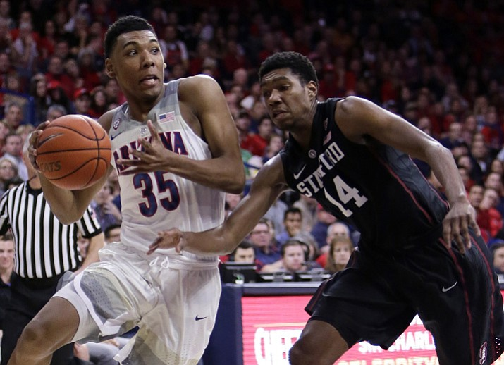 In this Feb. 8, 2017, file photo, Arizona guard Allonzo Trier (35) drives on Stanford guard Marcus Sheffield during the second half of an NCAA college basketball game in Tucson, Ariz. Trier was selected to The Associated Press preseason All-America team on Monday, Nov. 6, 2017. (Rick Scuteri/AP, File)