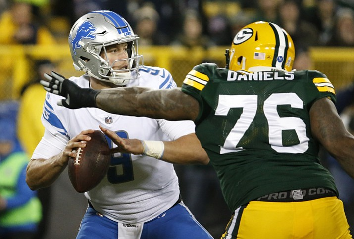 Detroit Lions' Matthew Stafford drops back with Green Bay Packers' Mike Daniels rushing during the first half Monday, Nov. 6, 2017, in Green Bay, Wis. (Mike Roemer/AP)