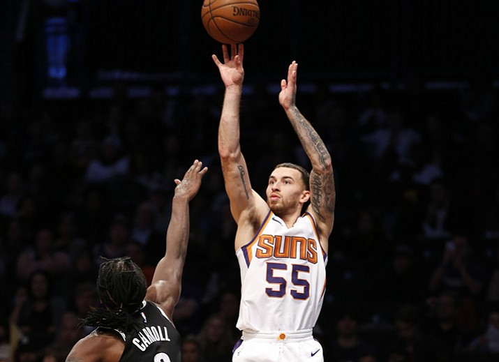 Phoenix Suns guard Mike James (55) shoots as Brooklyn Nets forward DeMarre Carroll (9) defends in the second half Monday, Nov. 6, 2017, in Phoenix. (Kathy Willens/AP)