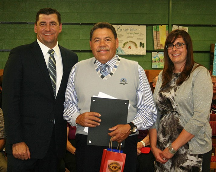 Superintendent Dan Streeter, left, and Glassford Hill Middle School Principal Melissa Tannehill, right, congratulate Mr. Rosario recently. (Courtesy)