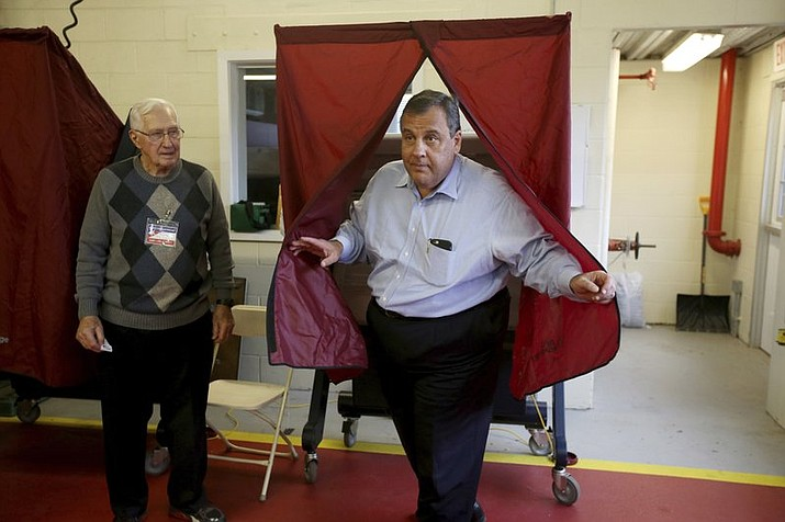 Gov. Chris Christie walks out of the voting booth after casting his ballot on Tuesday, Nov. 7, 2017 in Mendham, N.J. Democrat Phil Murphy and Republican Lt. Gov. Kim Guadagno are the two major party candidates vying to replace Christie, the two-term, term-limited incumbent. (Ed Murray/NJ Advance Media via AP)