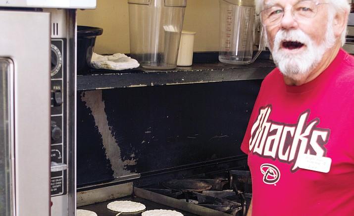 Lee Dudley of the Elks Lodge flips pancakes. (Troy Weigel/Courtesy)
