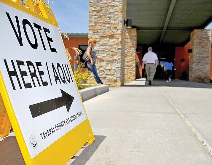 Prescott voters file into a polling place during an earlier election. A federal lawsuit claims at least 26,000 Arizona residents were denied the right to vote because of the state's voter ID law. (Courier file photo)
