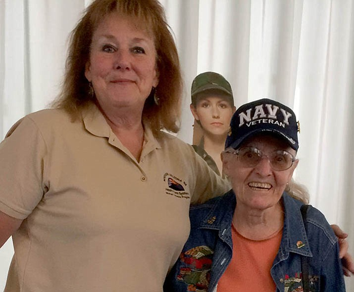 Navy veteran Mary Guertin, right, at the Veterans Outreach Nov. 7 at the Prescott Valley Public Library has accepted the offer of Susan Johnson-Molina to ride on Saturday's Veterans Day parade float with other women vets. (Sue Tone/Tribune)