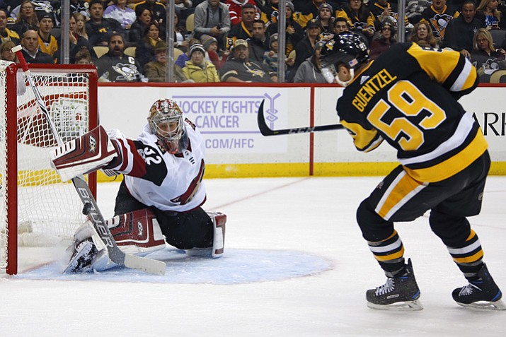 Arizona Coyotes goalie Antti Raanta (32) blocks a shot by Pittsburgh Penguins' Jake Guentzel (59) during the second period Tuesday, Nov. 7, 2017, in Pittsburgh, Pa. (Gene J. Puskar/AP)