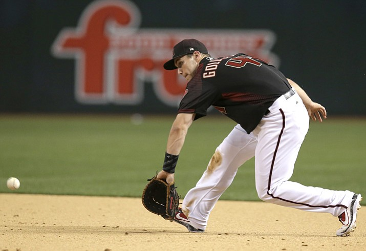In this April 8, 2017, file photo, Arizona Diamondbacks first baseman Paul Goldschmidt (44) fields the ball during a baseball game against the Cleveland Indians in Phoenix. Goldschmidt won his third Gold Glove on Tuesday, Nov. 7. (Rick Scuteri/AP, File)