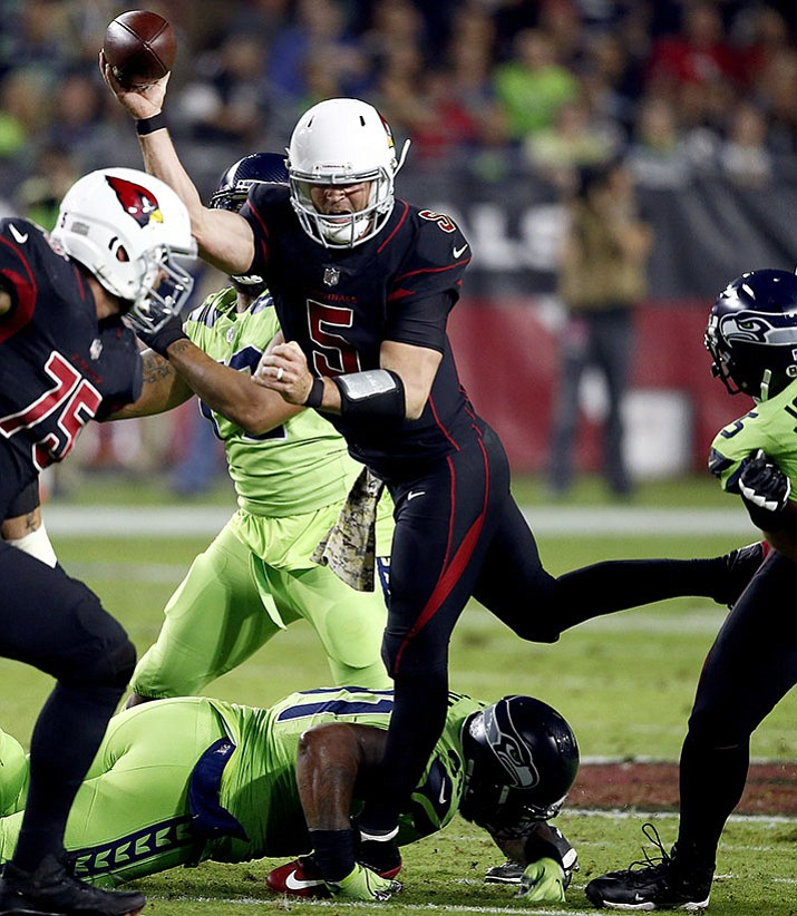 Arizona Cardinals quarterback Drew Stanton (5) gets off the pass against the Seattle Seahawks during their game Thursday, Nov. 9, 2017, in Glendale.