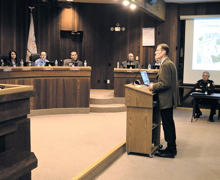 Steven Latoski, Mohave County Public Works Director, speaks of possible downtown developments to city council at a meeting in February.
