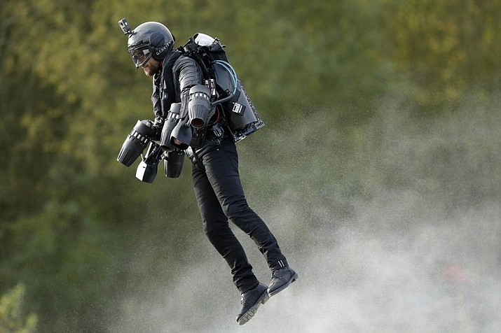 A British inventor billed as a real-life version of the superhero Iron Man has hit the fastest speed in a body-controlled jet engine power suit at 32 mph (51 kph) to set a new Guinness world record. The record keeper announced Tuesday's feat on Thursday as part of its annual Guinness World Records day. (Tim Ireland/PA via AP)