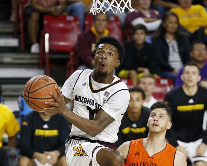 Arizona State guard Shannon Evans II, left, drives past Idaho State guard Geno Luzcando (1) during the second half of an NCAA basketball game Friday, Nov. 10, 2017, in Tempe. (Ross D. Franklin/AP)