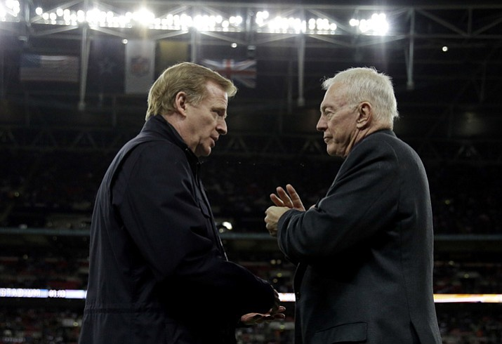 In this Nov. 9, 2014, file photo, NFL commissioner Roger Goodell, left, and Dallas Cowboys owner Jerry Jones talk during an NFL football game between the Jacksonville Jaguars and Cowboys at Wembley Stadium in London. The NFL expects a five-year contract extension with Commissioner Roger Goodell to be finalized soon, despite a threatened lawsuit by Dallas Cowboys owner Jerry Jones. (Matt Dunham/AP, File)