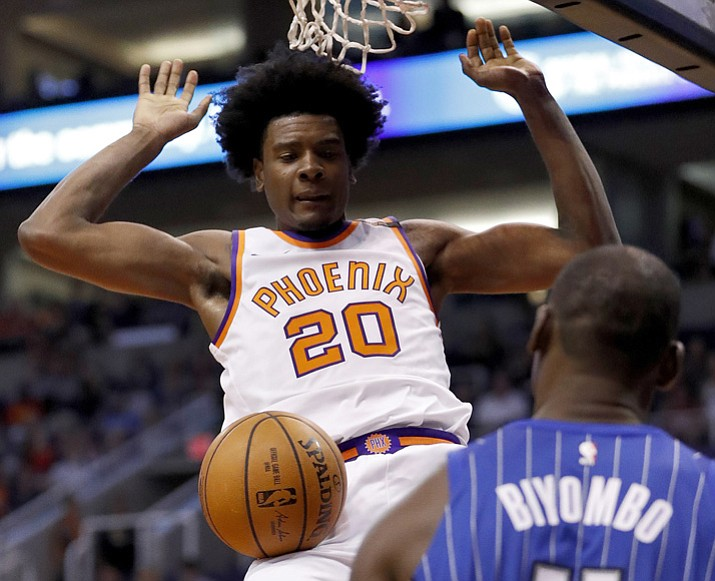 Phoenix Suns forward Josh Jackson (20) dunks as Orlando Magic center Bismack Biyombo (11) looks on during the second half of an NBA basketball game, Friday, Nov. 10, 2017, in Phoenix. (Matt York/AP)