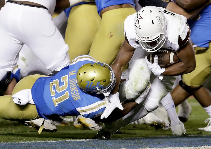 Arizona State running back Demario Richard, right, scores past UCLA's Mossi Johnson during the first half of an NCAA college football game in Pasadena, Saturday, Nov. 11, 2017. (AP Photo/Chris Carlson)