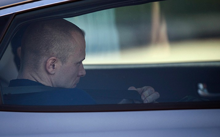 Bowe Bergdahl, who was demoted from sergeant to private, is driven away from the Fort Bragg courtroom facility on Friday, Nov. 3, 2017, on Fort Bragg, N.C. Bergdahl, who walked off his base in Afghanistan in 2009 and was held by the Taliban for five years, was given a dishonorable discharge, a reduction in rank, a forfeiture of pay but was spared a prison sentence. (Andrew Craft /The Fayetteville Observer via AP)