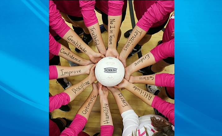 "Camp Verde volleyball players wrote their ""character matters"" words that they implemented   through out the season on their arms. Sophomore middle Kendall Peterson had the idea for the photo (Photo courtesy Britney Armstrong)."